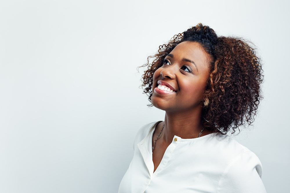 Smiling-woman-white-backdrop.jpg