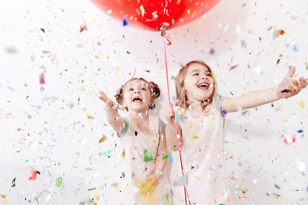 Little-girls-celebrating-confetti-balloon.jpg