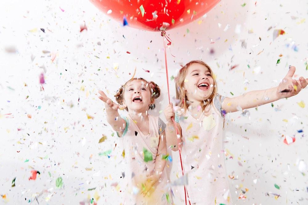 Little-girls-celebrating-confetti-balloon.jpg