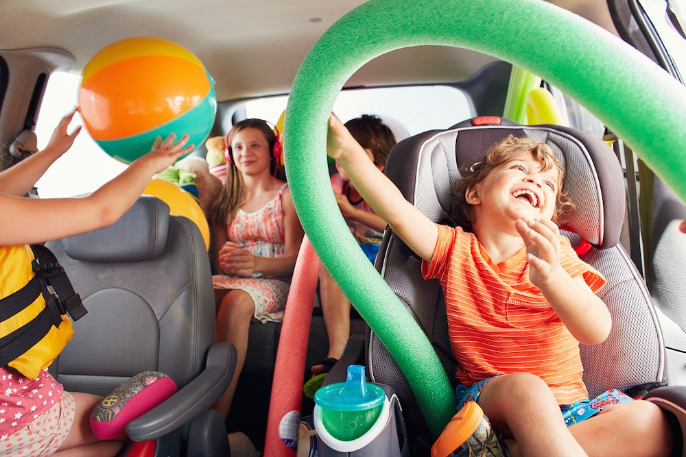 Family-car-summer-vacation-children-playing-laughing.jpg
