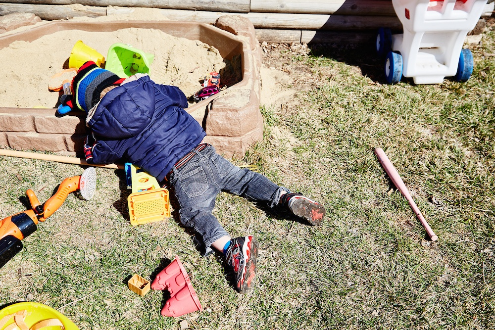 Boy-falling-asleep-sandbox.jpg