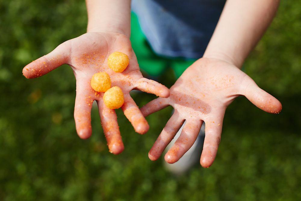 Child-cheesy-puffs-hands.jpg