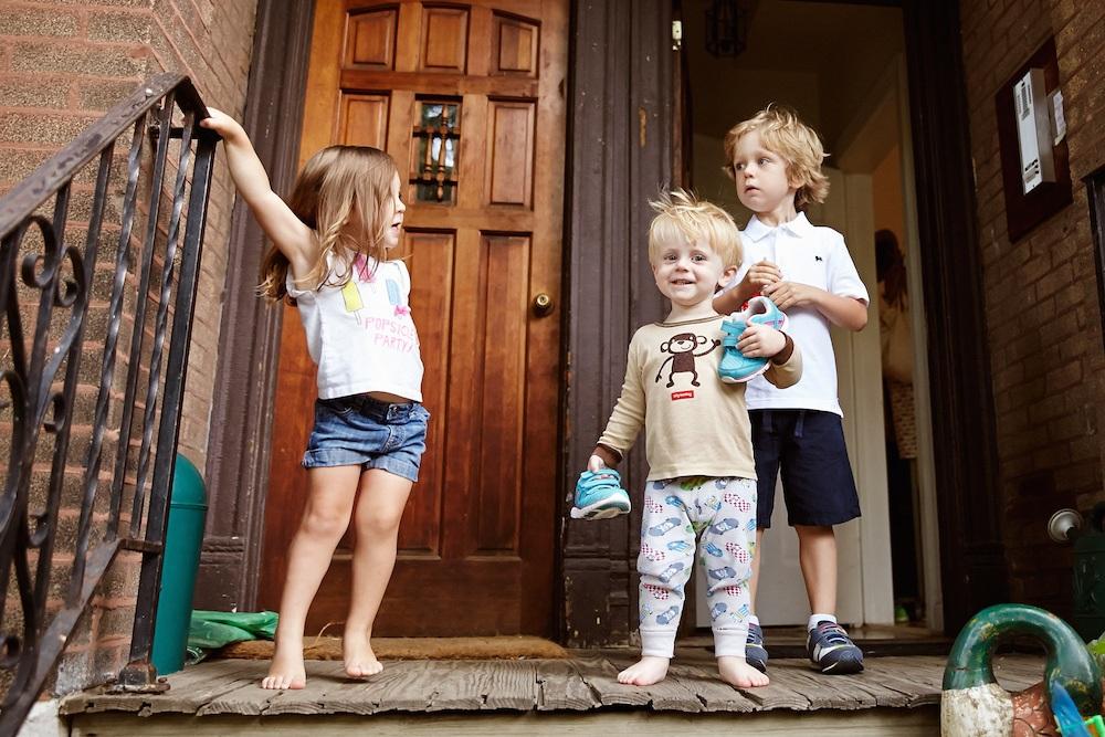 Three-children-wooden-doorway.jpg