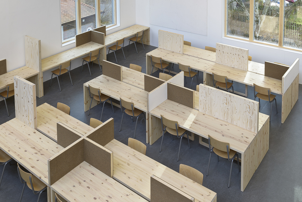 Wimbledon College of Art  January 2015  The interior we designed for the new studio building at Wimbledon College of Art has just been installed. Desks for 80 students and a simple system of movable panels and desk screens. Read more  here .