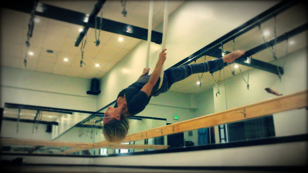 "Salina flying around AntiGravity®Fitness ""Shooting Comet Swings"""