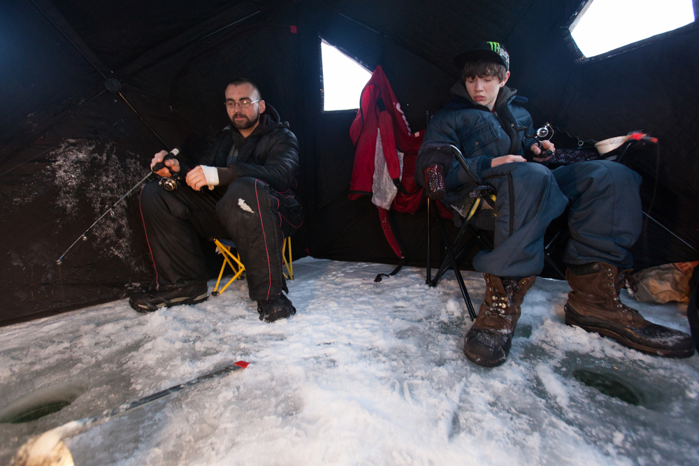 "With a lantern and heater inside their tent, Snyder and O'Donnell settle in and fish. ""The tent protects us from the wind. You would otherwise feel the cold when it's blowing 35mph,"" said O'Donnell."