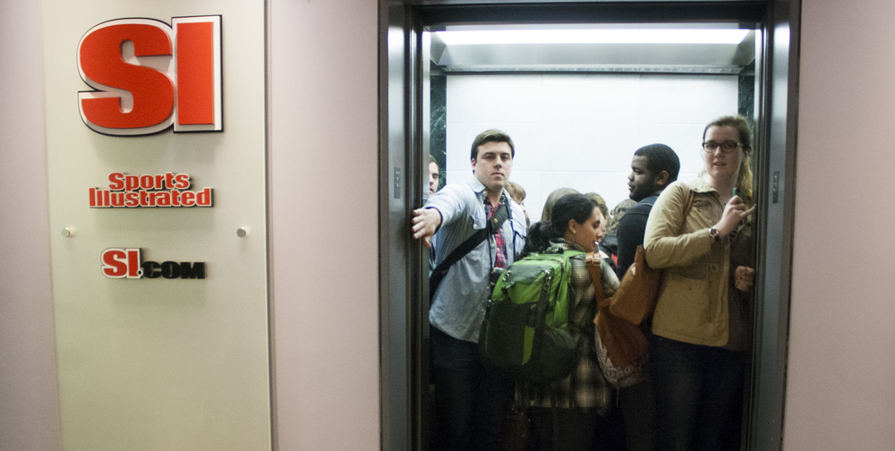 Third year photojournalism students crowd in the elevator after the week's last stop, Sports Illustrated.
