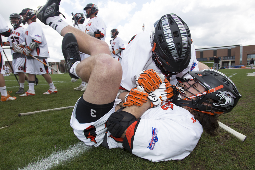 Cody Jones #29, left, and Denning Crenshaw #3, right, of the RIT Tigers celebrate a goal against Union College in the Liberty League Championship game on Sunday, May 4, 2014,  at Tiger Stadium in Henrietta, N.Y. For the third straight year, the RIT men's lacrosse team sits atop the Liberty League Conference after winning the game 13-11.