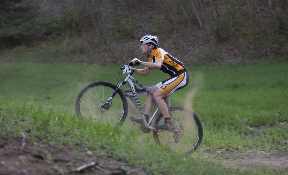 Connor Reardon kicks up dirt as he approaches a steep climb after a descent.