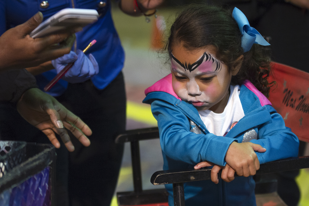 Peighsyn Lemke, 3, refuses the finishing touches of her kitten face paint.