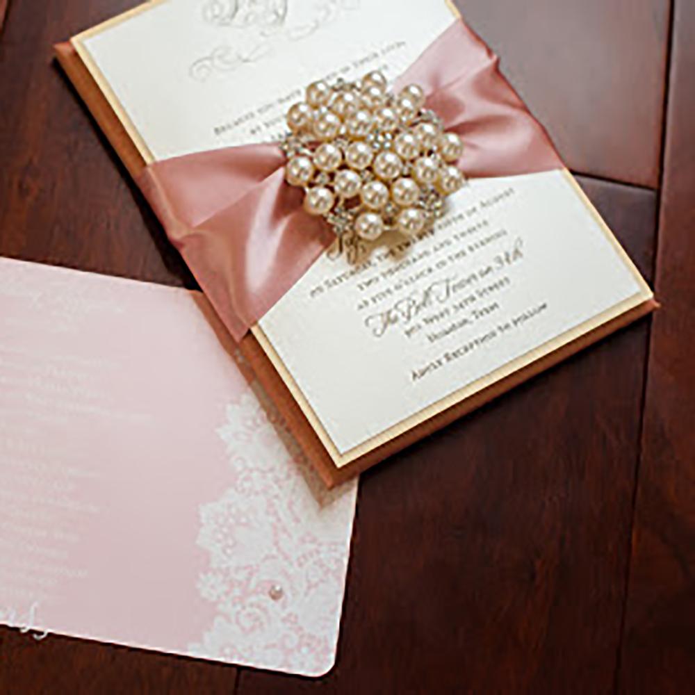 Silk Pad invitation with satin ribbon and Pearl Brooch by Isabella Invitations, Houston, Texas.