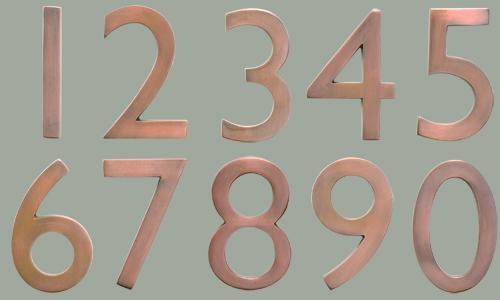copper house numbers from architectural mailboxes make stylish table numbers