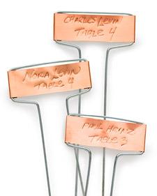 copper garden stakes used as escort cards via martha stewart weddings