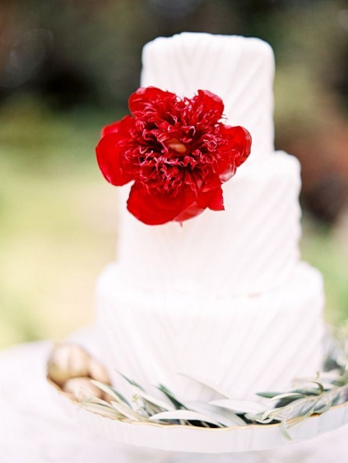 Wedding cake with single red flower accent. Cake by Peche Petite, flowers by Flowers by Yona, photo by Morning Light by Michelle Landreau. Featured on Ruffled Blog.