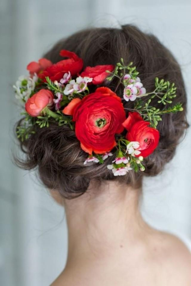Romantic updo bedecked with red ranunculus. Photo by Valerie Busque Photography, featured on Style Me Pretty.