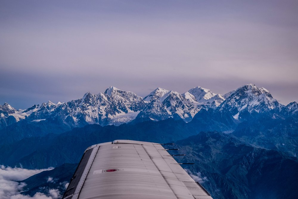 The Langtang Range,  seen here rising above the early morning mist and cloud cover, will be the first and last peaks you see on your flight.