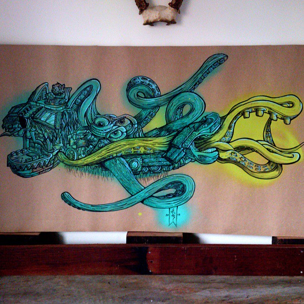 Lean green submarine. Up for grabs,100x55cm Mounted #artwork #spraypaint #marker #ink #surreal #arty #artist #designer #streetart #staghorns #cardboard #illustration #painting #green #eco #animal #tentacle #mouth #pilot #swimming #speckles #sub #sydney #keepitlocal
