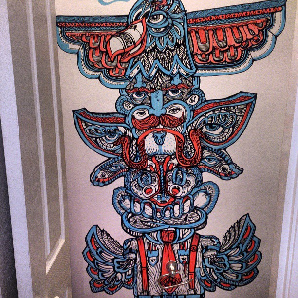 Tots looks like a totem. #walltattoo #mural #streetart #graffiti #illustration #ink #penandink #draw #marker #blue #red #painting #moustache #beard #beardlove #mo #stash #bear #eagle #wings #eye #illusion #teeth #awesome #detailed
