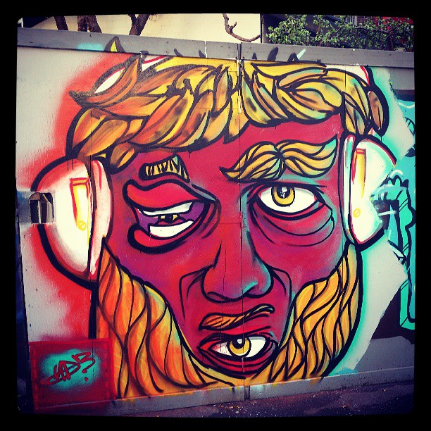 This shit is bananas.chill Sat sway at @workshopaus #streetart #graffiti #art #face #music #headphones #eyes #drugged #confused. #hair #fruit #beard #beardlove #colours #sydneyart #illustration