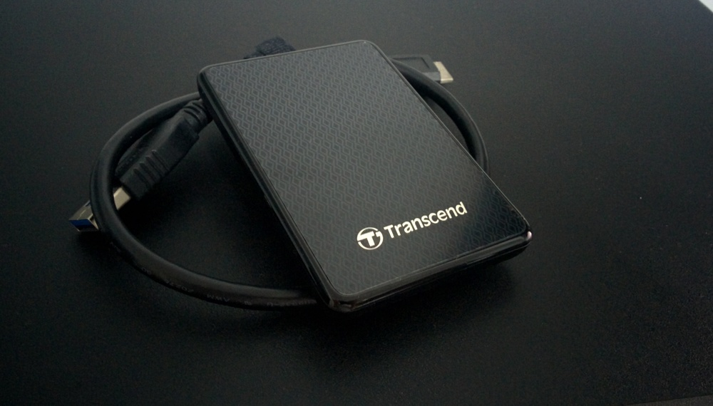 My portable Transcend SSD. Great value for fast large file transfer.