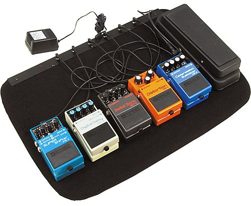 An image of a guitar pedal board, Credits  GuitarCenter