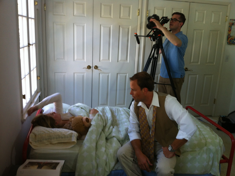 Director/DP Benjamin Walter shoots a scene with Jayna Sweet (Emily) and Matt Cooper (Dad) in Emily's bedroom.