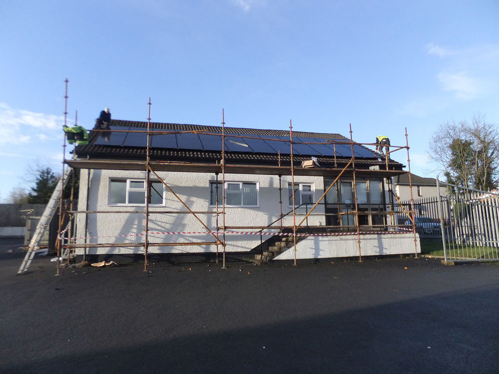 Installing Solar PV panels.