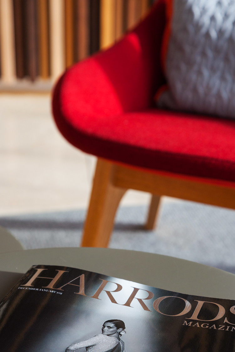Harrods magazine with chair in the background