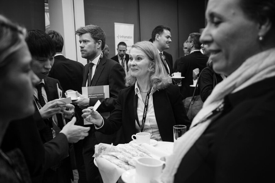 Woman passes her business card at networking event