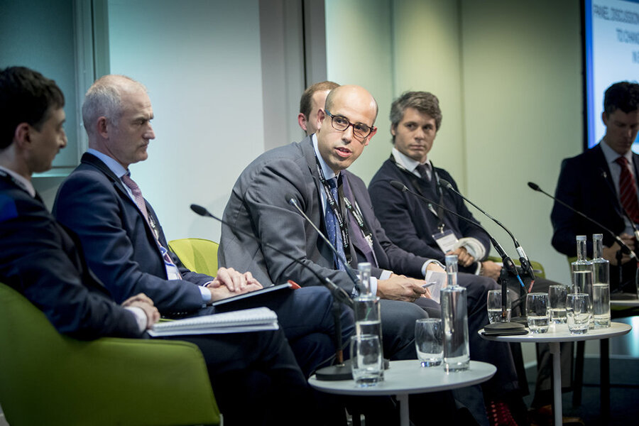 Man in glasses on conference panel