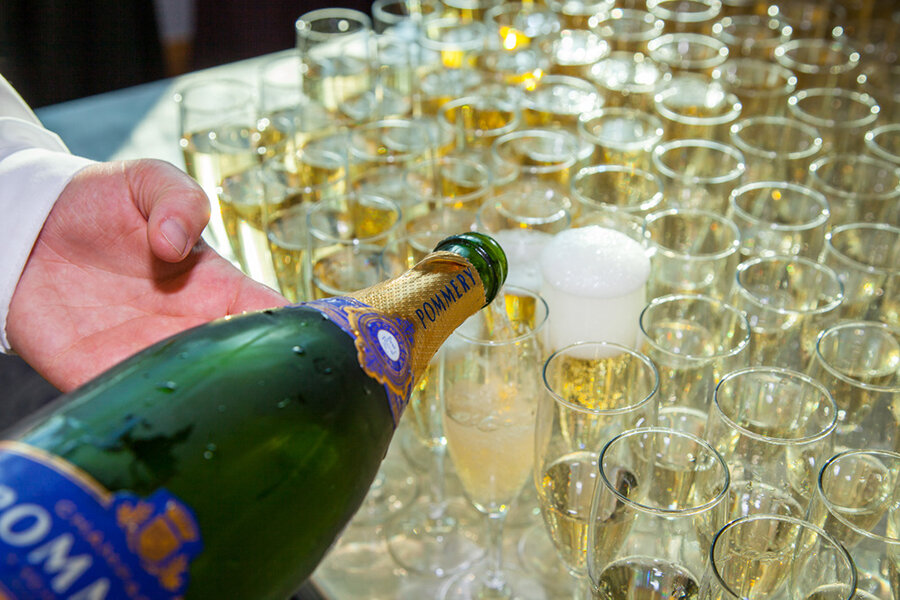 Pouring the champagne for the guests.