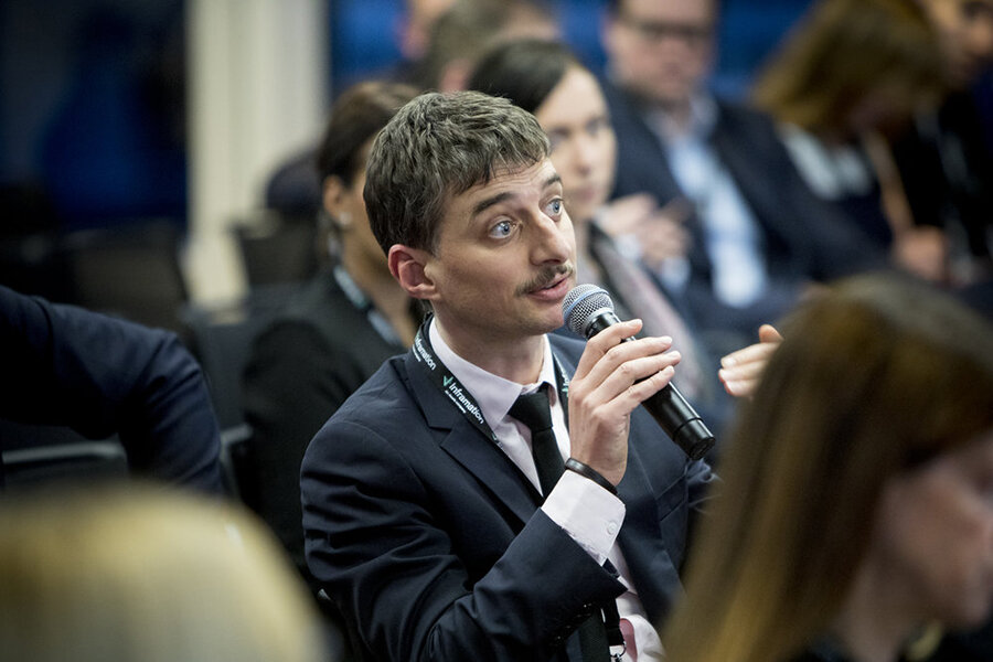 Man holding microphone asking question