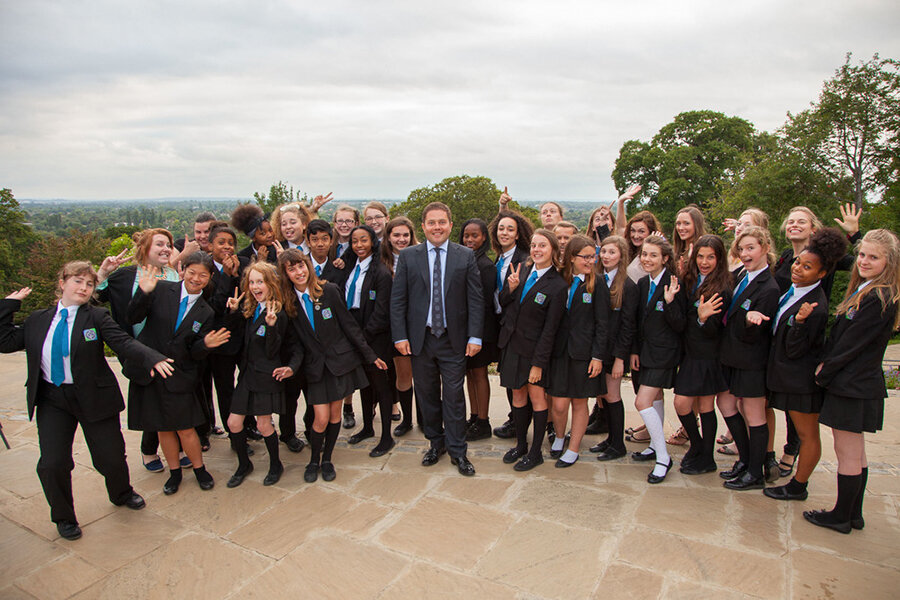 Man standing in front of a schoolgirl choir