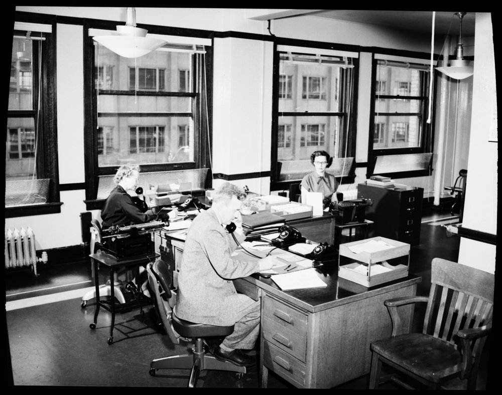 Author:   Seattle Municipal Archives   Author URL:   https://www.flickr.com/people/seattlemunicipalarchives/   Title:   City Light employees in office, 1954   Year:   1954