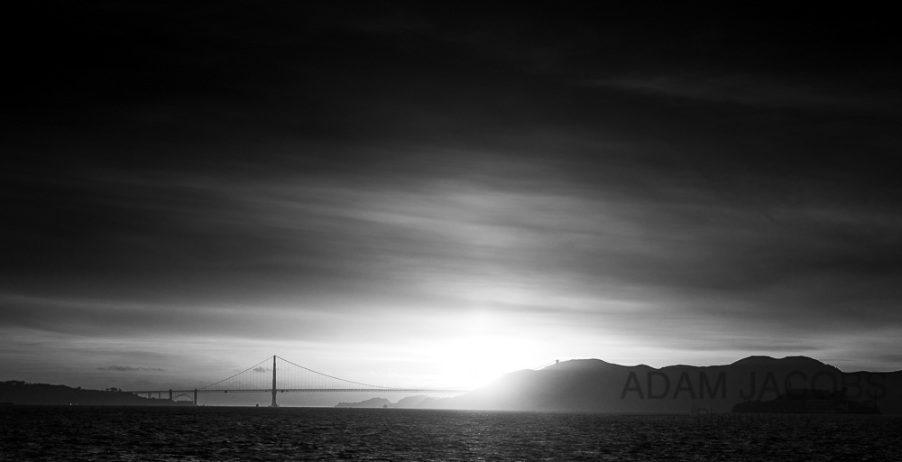 Sun sets behind Golden Gate Bridge - Fine Art Black and White Landscape Photography For Sale Adam Jacobs