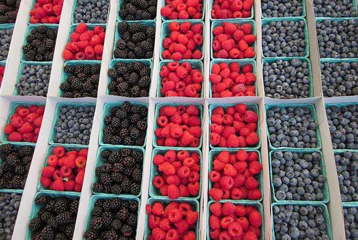 Raspberries, blueberries and blackberries at Brentwood Farmers Market, Los Angeles