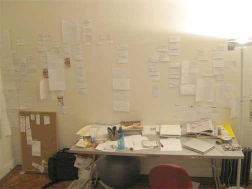A picture of my studio getting messier with more storyboards on the wall.