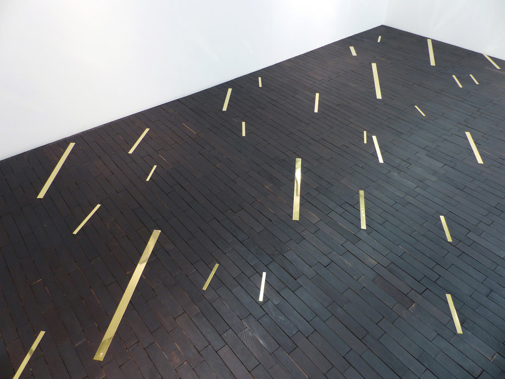 UNTITLED (FLOOR)(detail) - Charred reclaimed parquet floor with brass inlay484 x 300 cm2017