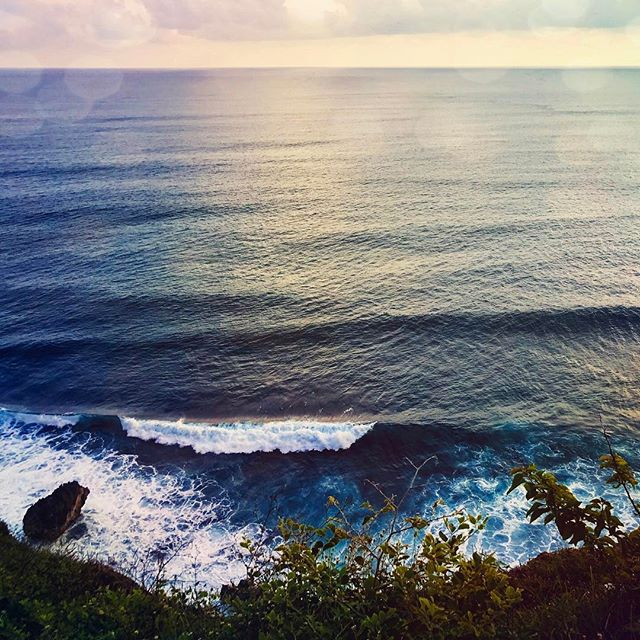 """""""Smell the sea water mist rising from the waves, crashing against the rock."""" #bali #colors #ocean #uluwatu #temple #sunset"""