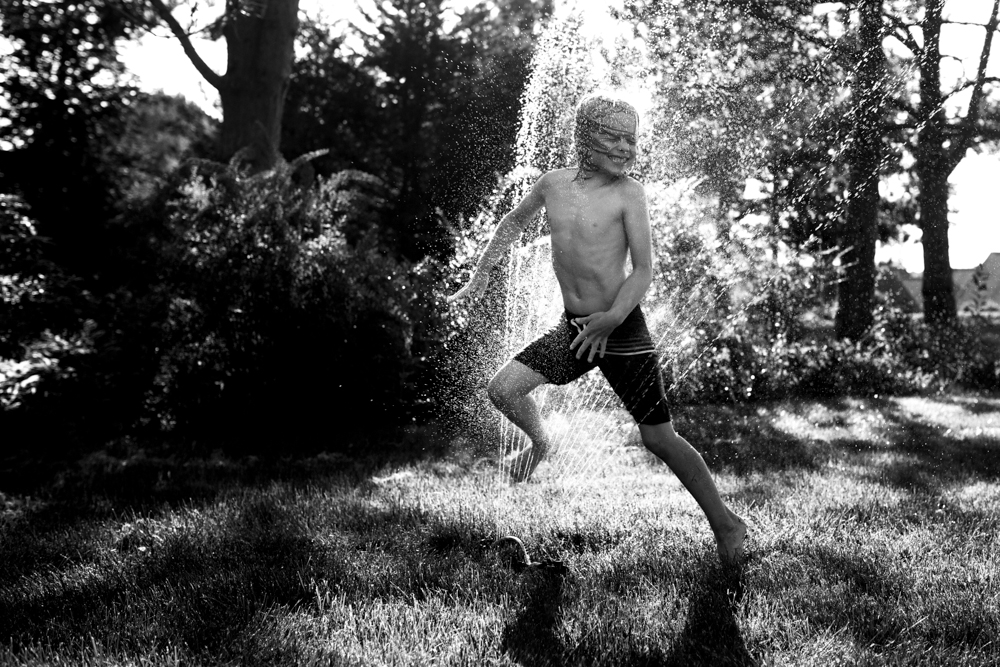 253/365 frolicking in the sprinkler, looking very big and strong
