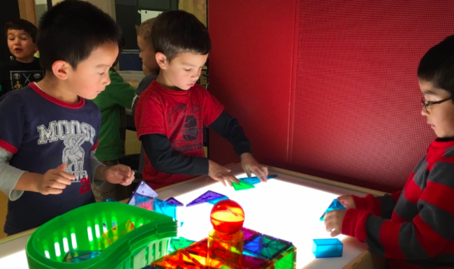 kindergarteners enjoy their classroom light table, purchased through bsco's teacher grant program in 2015.