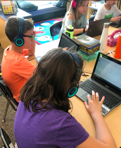 Third graders enjoy the new BSCO purchased headphones.