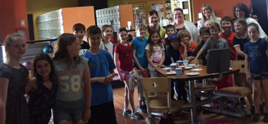 Fourth grade students pose with teachers at Sunset Lanes during their bowling party.