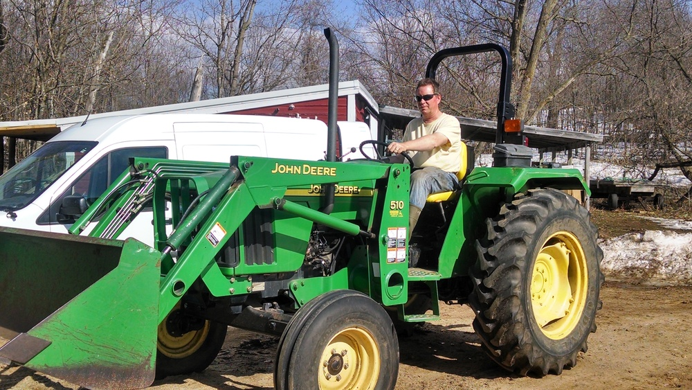 This farmer loves the sweet hum of his tractor!