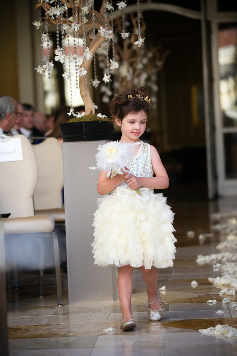 Our adorable flower girl decked in roses and feathers at Bellagio Las Vegas.