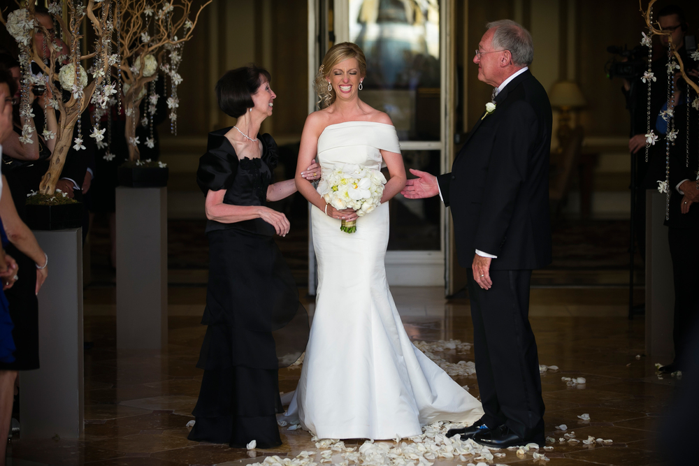 Marci was giddy as she joined her parents for her walk down the aisle at the Bellagio Las Vegas.