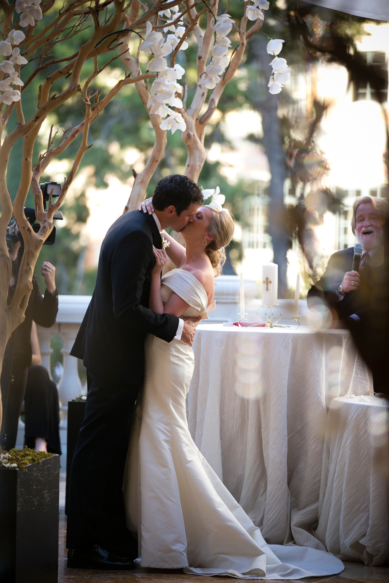 First Kiss on the Grand Patio at Bellagio Las Vegas Destination Wedding.