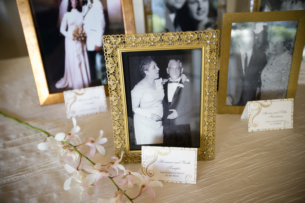 Framed wedding photos celebrated the marriages on each side of the family at Bellagio Las Vegas.