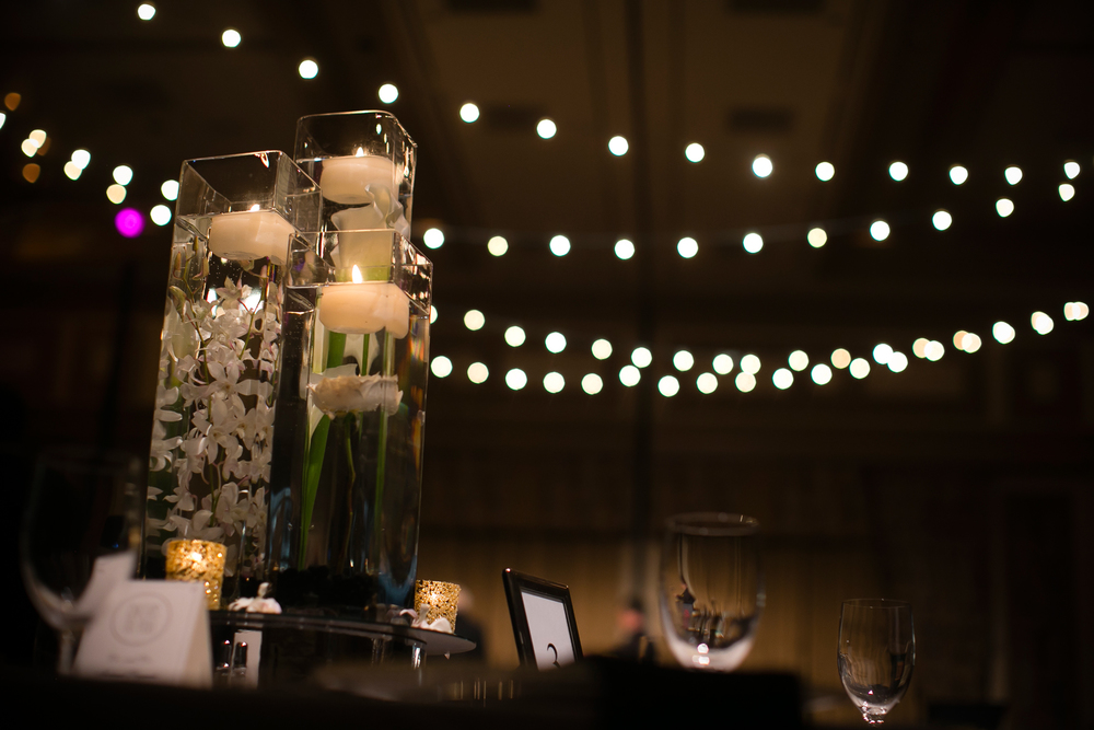 Submerged orchids topped with floating candles at Bellagio Las Vegas Wedding.