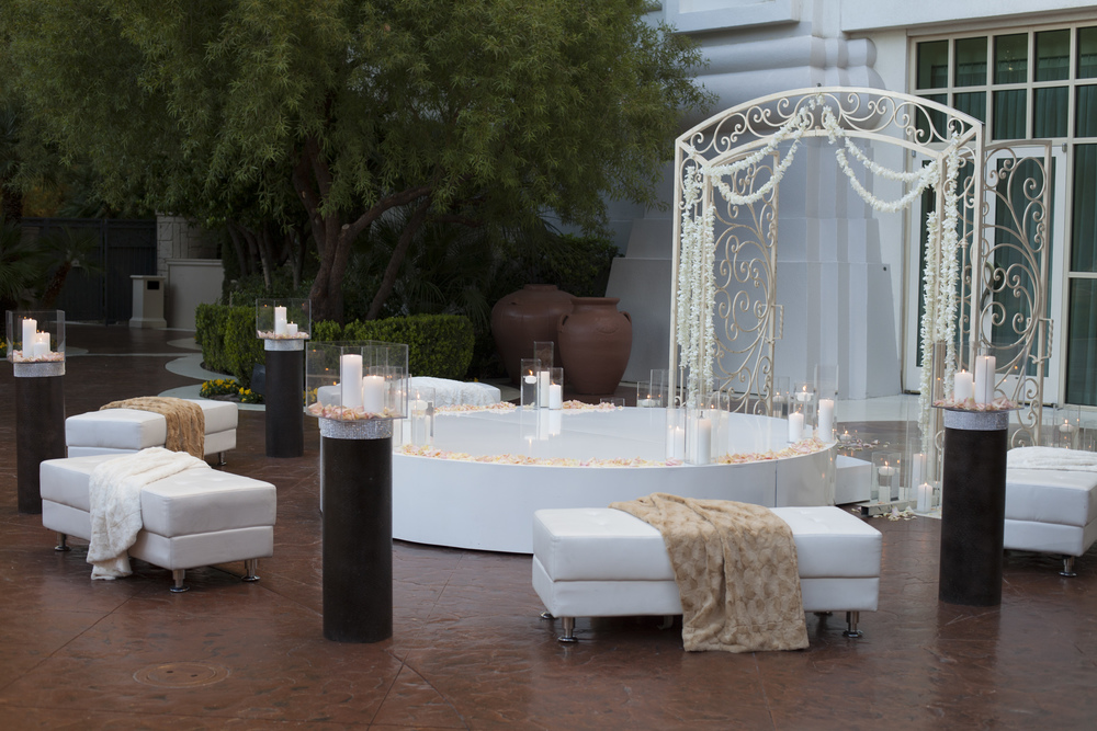 The ceremony featured a Tuscan gate, a raised white dance floor, and black accents.  White leather benches were topped with fur throws to add a touch of luxury and romance. Four Seasons Las Vegas.